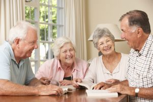Group Of Senior Couples Attending Book Reading Group